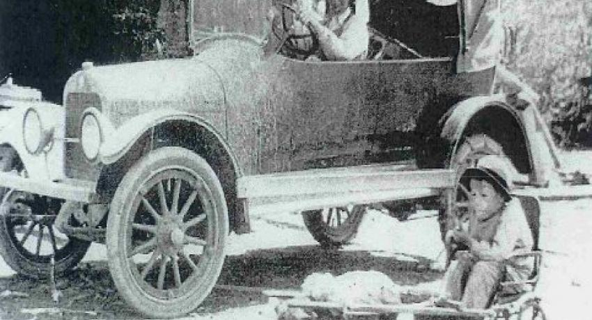 "Lorin Walker in his Marmon automobile with crippled son, Franklin, and pig ""Daisy"""