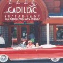 1960 Cadillac Eldorado Biarritz Convertible in front of the Cadillac restaurant in Jackson Hole, WY.